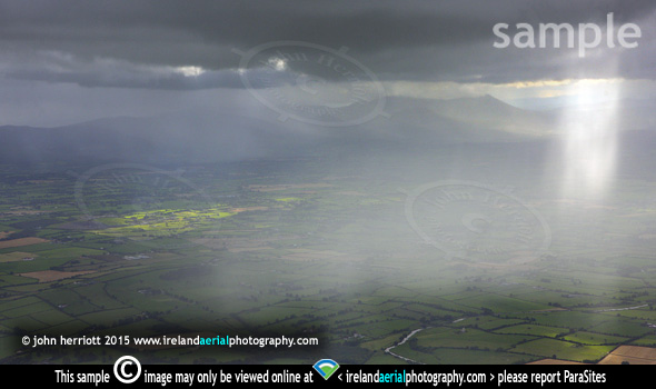 Heavens Above, rain over Cashel and Galty Mountains